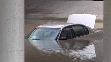 Flood Waters Trap Two Vehicles In Downtown Mansfield