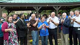 Mansfield PAL Cuts The Ribbon On A Gazebo