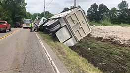 Semi Rollover Accident Spills Slag In Field At SR 545
